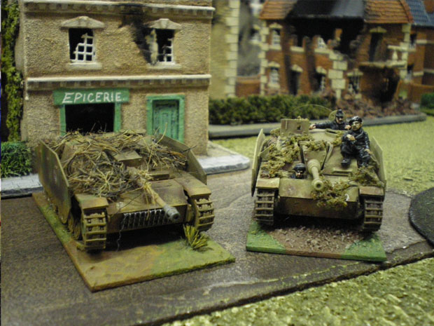 Stugs in the shade of a wood