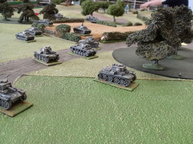 Panzer Division moving out to the assault.
