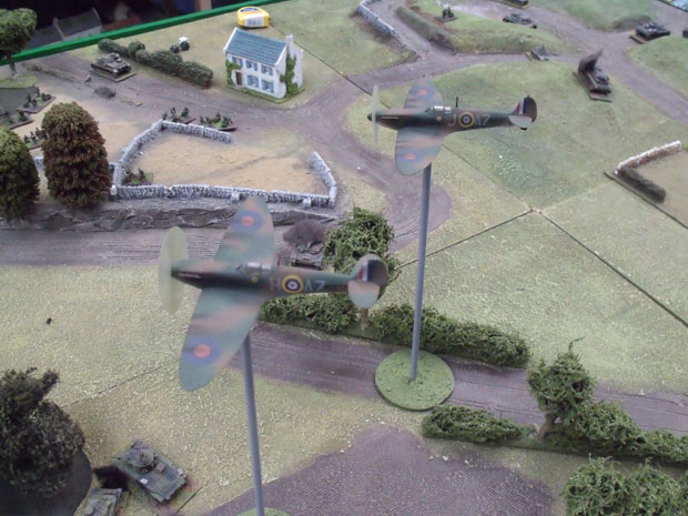 Spitfires covering the advance ofthe British Armour.