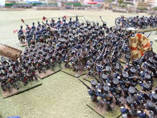 Prussian infantry retire through their own lines.