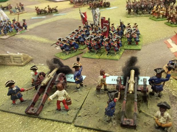 Heavy Guns firing on the advancing German troops.